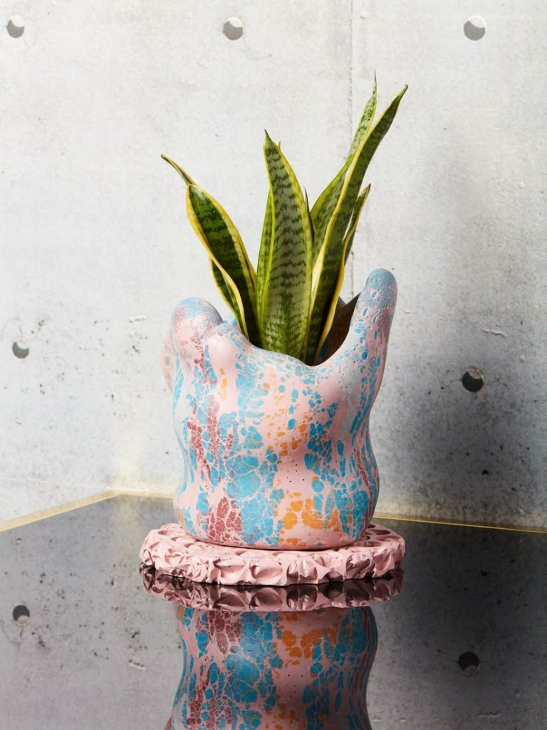 Decorative Indoor Planter in pink, blue and orange finish.